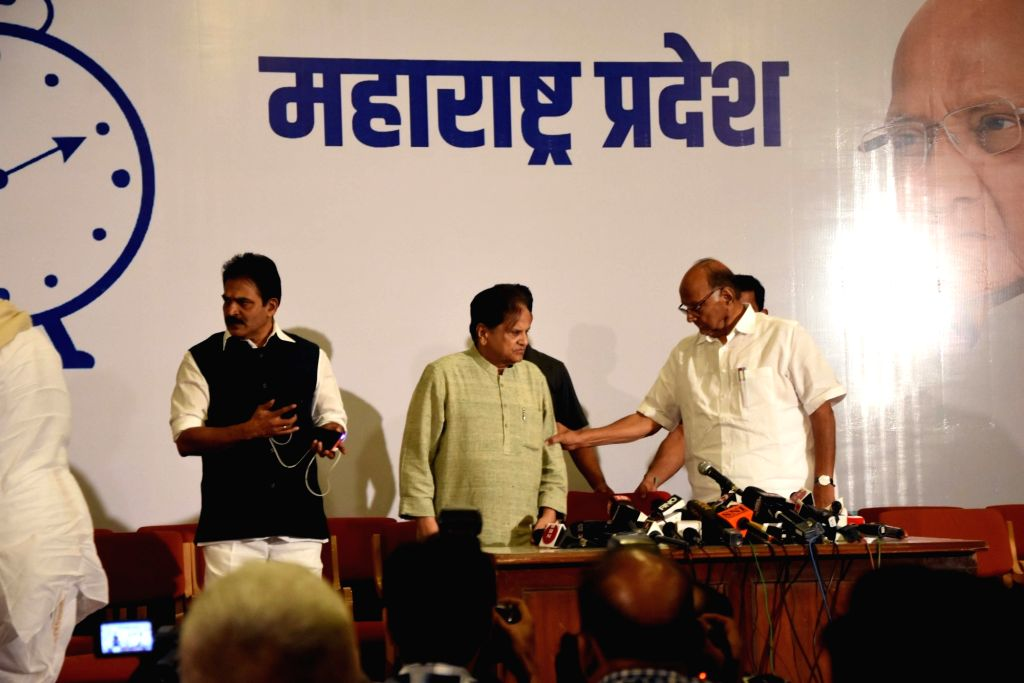 NCP chief Sharad Pawar, Congress leaders KC Venugopal and Ahmed Patel during a joint press conference, in Mumbai on Nov 12, 2019. - Ahmed Patel