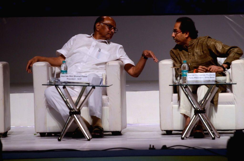 NCP chief Sharad Pawar interacts with Shiv Sena chief Uddhav Thackeray during the Centenary celebration ceremony of Saraswat Bank in Mumbai on Sept 15, 2018.