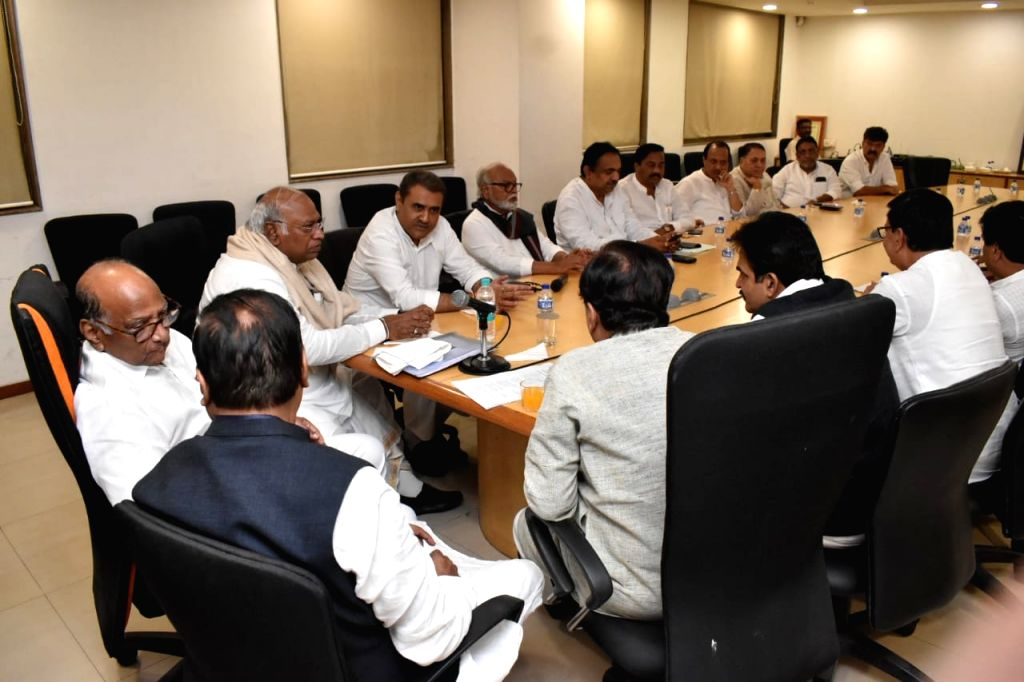 NCP chief Sharad Pawar, party leaders Chhagan Bhujbal, Prithviraj Chavan and Congress leaders Mallikarjun Kharge, KC Venugopal and Ahmed Patel during a joint party meeting to discuss issues ... - Ahmed Patel