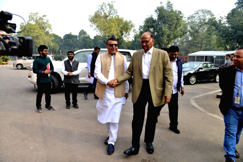 NCP chief Sharad Pawar (R) at Parliament in New Delhi on Dec 4, 2019. Also seen Media baron Subhash Chandra.