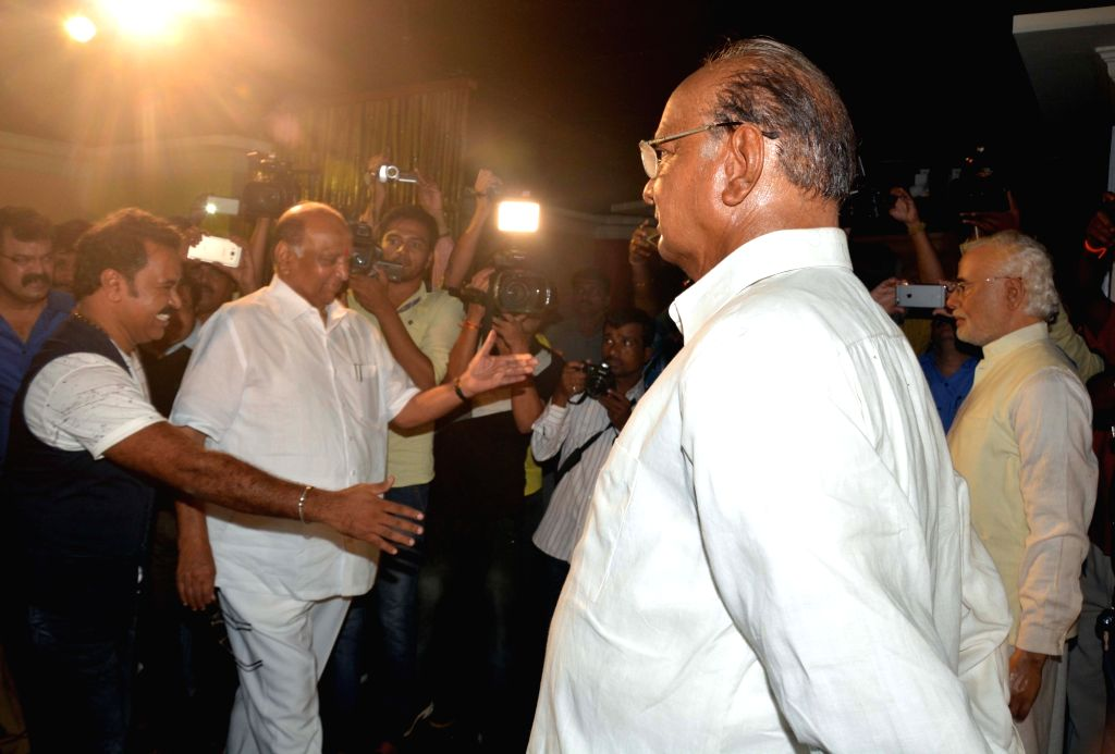 NCP chief Sharad Pawar with his wax statue at Celebrity Wax Museum in Lonavla of Maharashtra on July 4, 2016.