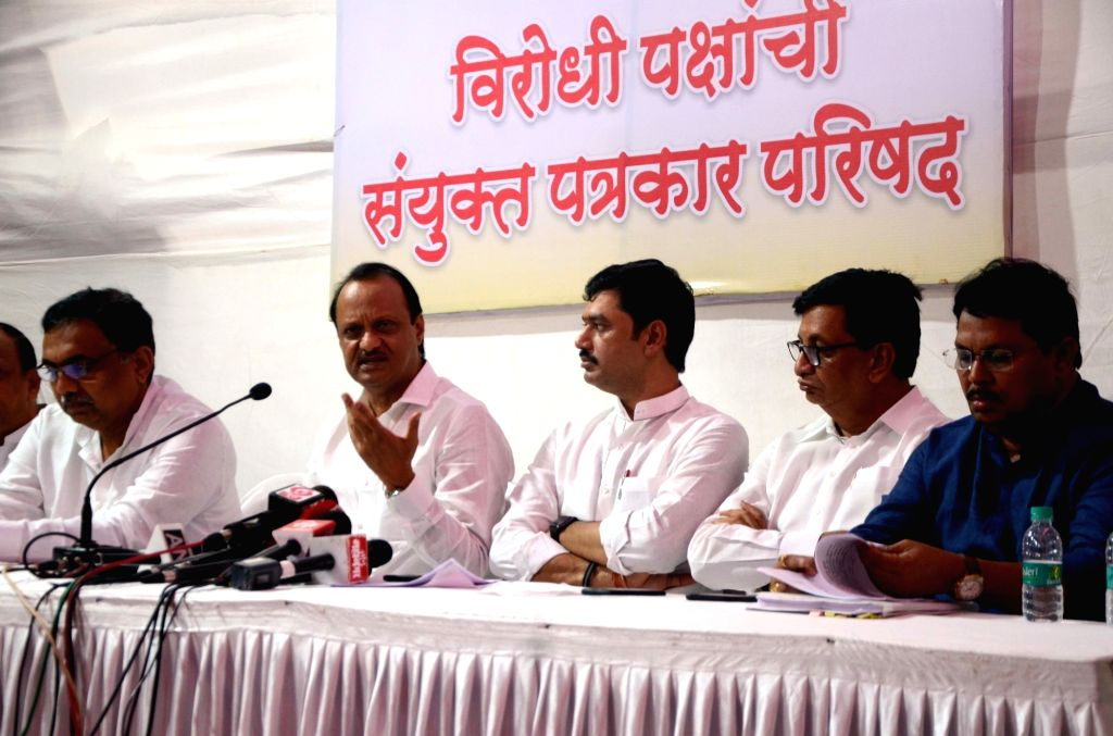 NCP leader Ajit Pawar accompanied by opposition party leaders Vijay Wadettiwar (Congress), Balasaheb Thorat (Congress) and others, addresess a press conference, in Mumbai, on June 16, 2019.