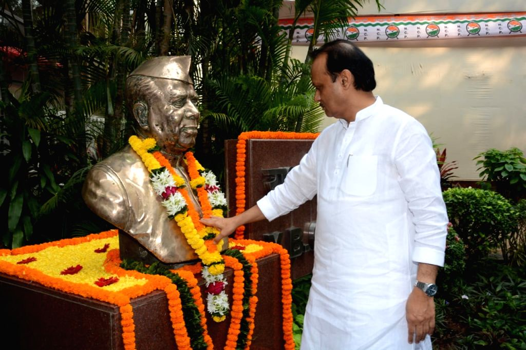 NCP leader Ajit Pawar pays tributes to the first Chief Minister of Maharashtra Yashwantrao Chavan during party chief Sharad Pawar's 80th birthday celebrations at YB Chavan Centre in Mumbai on ...