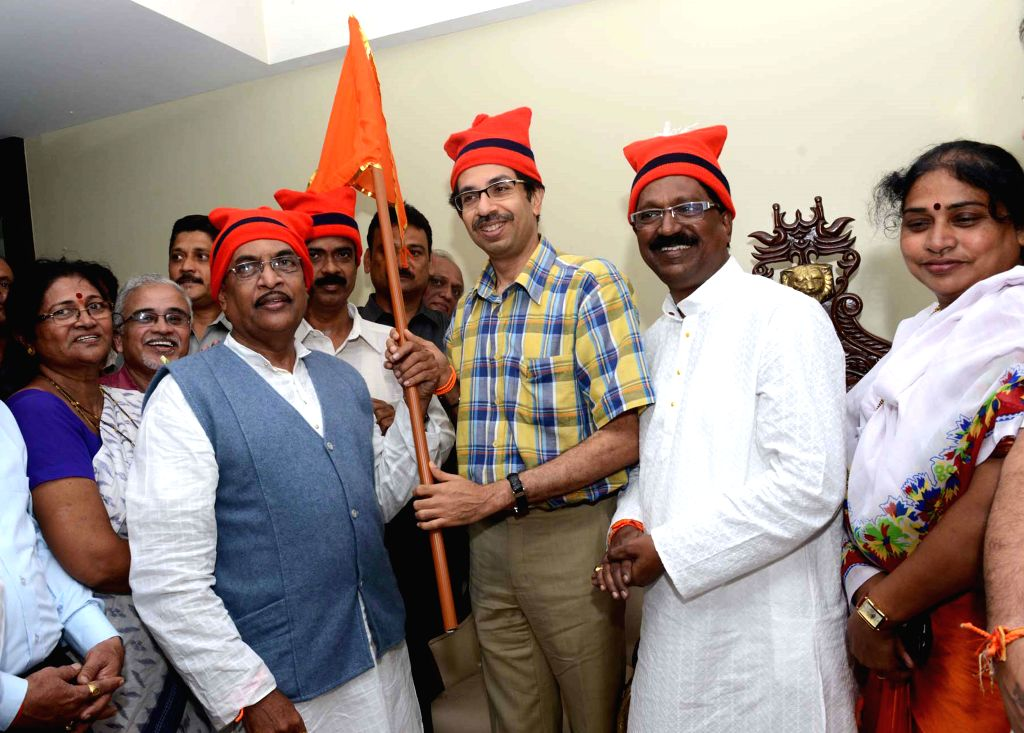 NCP leader Damodar Tandel and his supporters join Shiv Sena in presence of Shiv Sena chief Uddhav Thackeray in Mumbai on Aug 27, 2014.