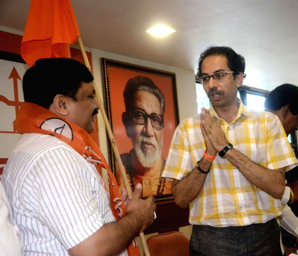 NCP leader  Kishor Kanhere joins Shiv Sena in presence of Shiv Sena chief Uddhav Thackeray in Mumbai on July 14, 2014.
