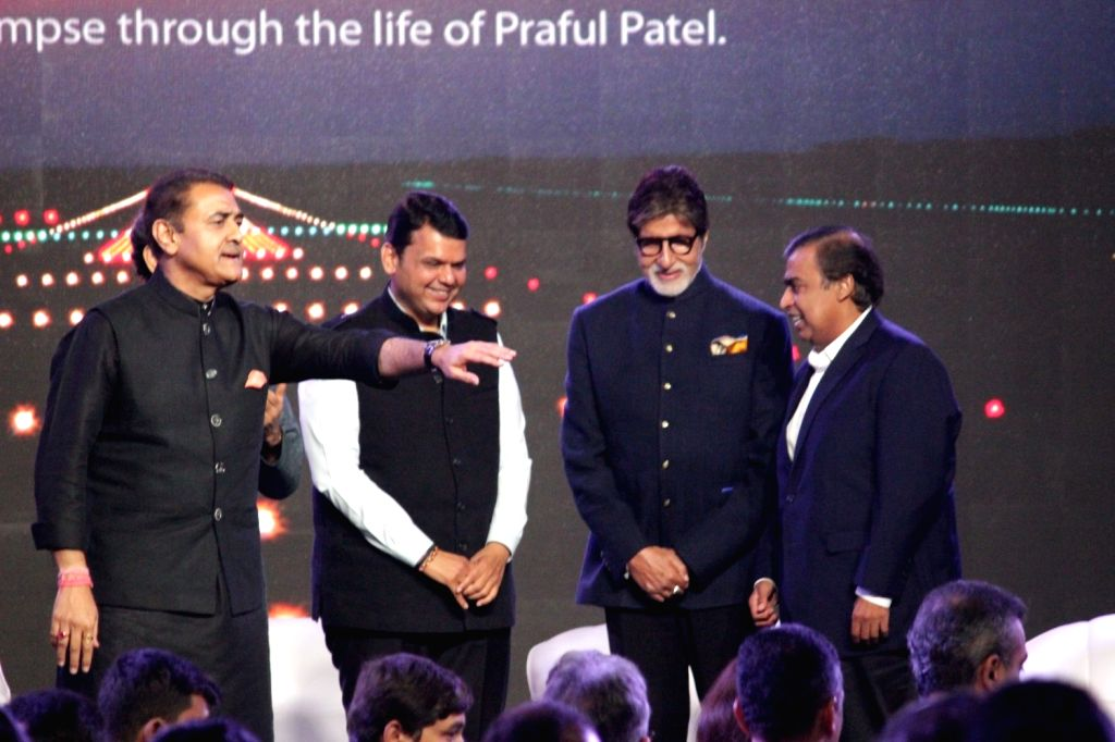 NCP leader Praful Patel, Maharashtra Chief Minister Devendra Fadnavis, actor Amitabh Bachchan, and business man, Mukesh Ambani during the launch of Nationalist Congress Party (NCP) leader ... - Devendra Fadnavis, Praful Patel, Amitabh Bachchan and Mukesh Ambani