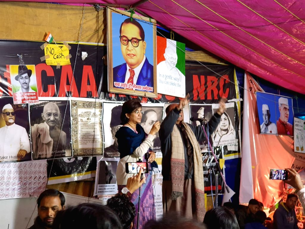 NCP leaders Majeed Memon and Vandana Chavan address the protesters staging a demonstration against the Citizenship Amendment Act (CAA) 2019, National Register of Citizens (NRC) and ...