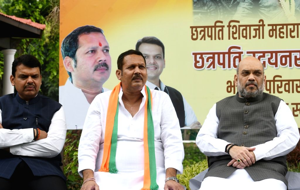NCP's Satara MP Chhatrapati Udayanraje Bhosale joins BJP in the presence of Union Home Minister Amit Shah and Maharashtra Chief Minister Devendra Fadnavis, in New Delhi on Sep 14, 2019. - Amit Shah