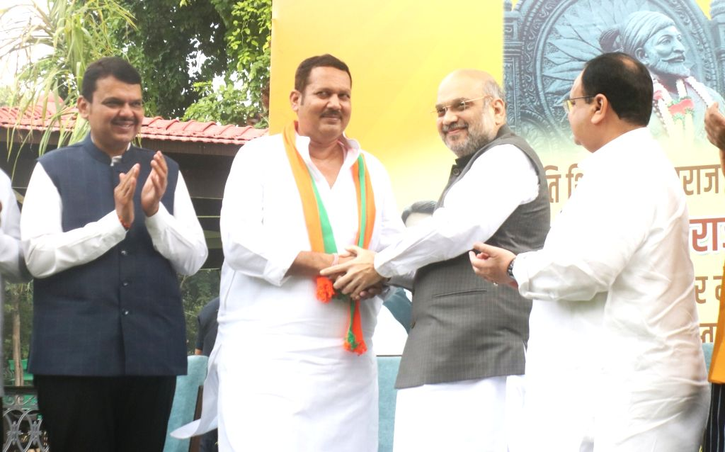 NCP's Satara MP Chhatrapati Udayanraje Bhosale joins BJP in the presence of Union Home Minister Amit Shah, BJP National Working President J.P. Nadda and Maharashtra Chief Minister Devendra ... - Amit Shah