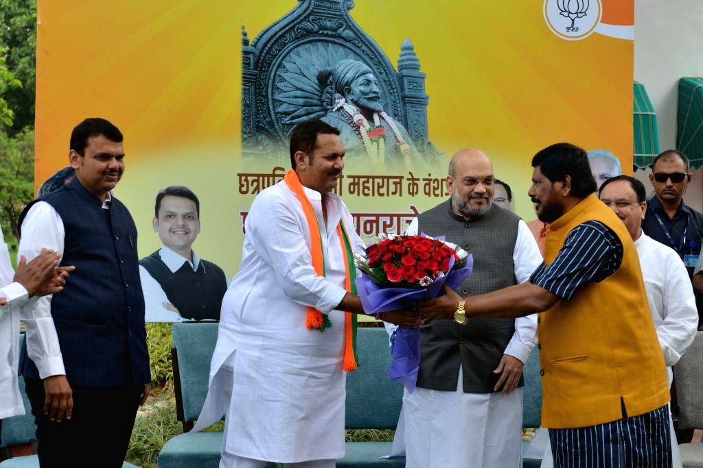 NCP's Satara MP Chhatrapati Udayanraje Bhosale being greeted by Union Minister Ramdas Athawale as Union Home Minister Amit Shah, BJP National Working President J.P. Nadda and Maharashtra ... - Ramdas Athawale and Amit Shah