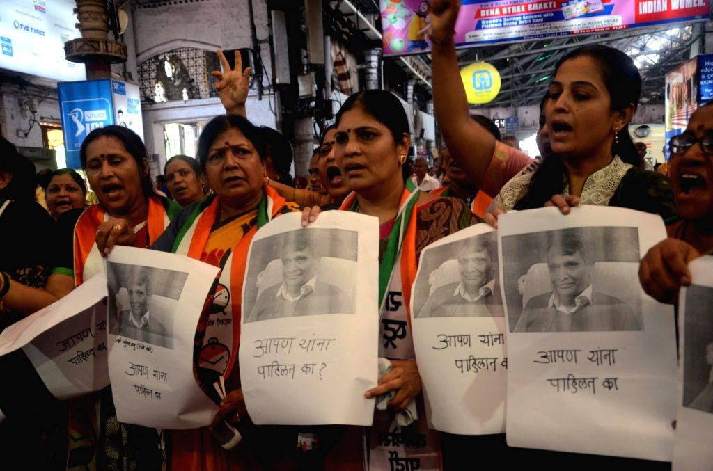 NCP wokers led by Surekha Pednekar stage a demonstration regarding local train passengers' grievances at CST in Mumbai, on June 22, 2016.