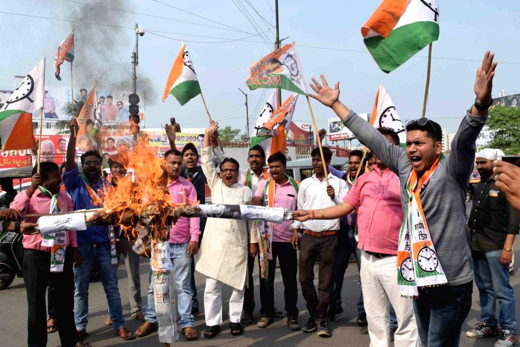 NCP workers burns an effigy of Union Agriculture Minister Radha Mohan Singh during a demonstration in Patna on April 6, 2018. - Radha Mohan Singh