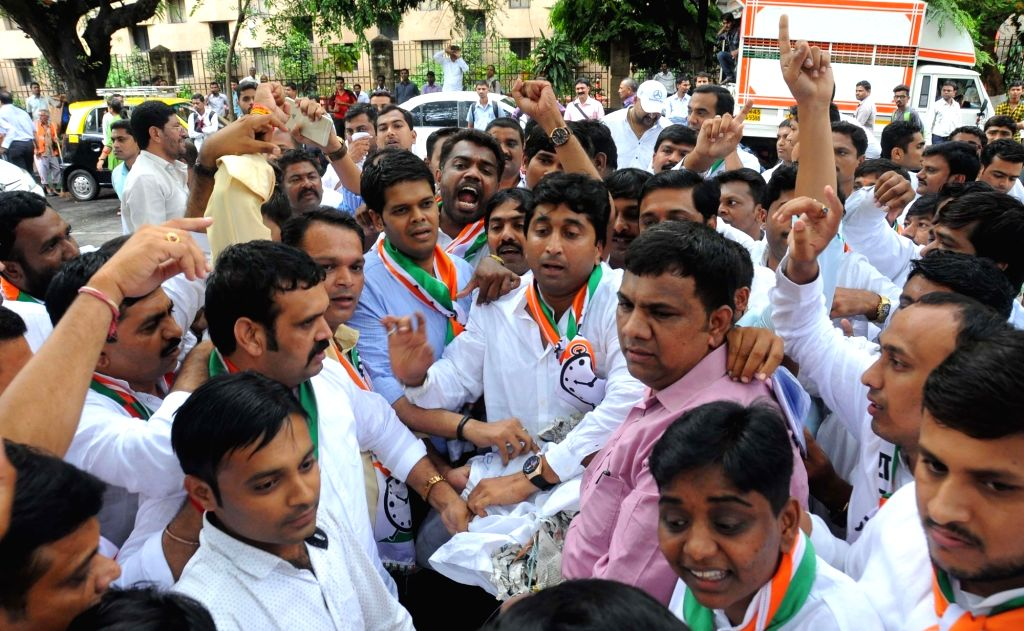 NCP workers led by Vasant Davkhare stage a demonstration against BJP in Mumbai, on June 23, 2016.