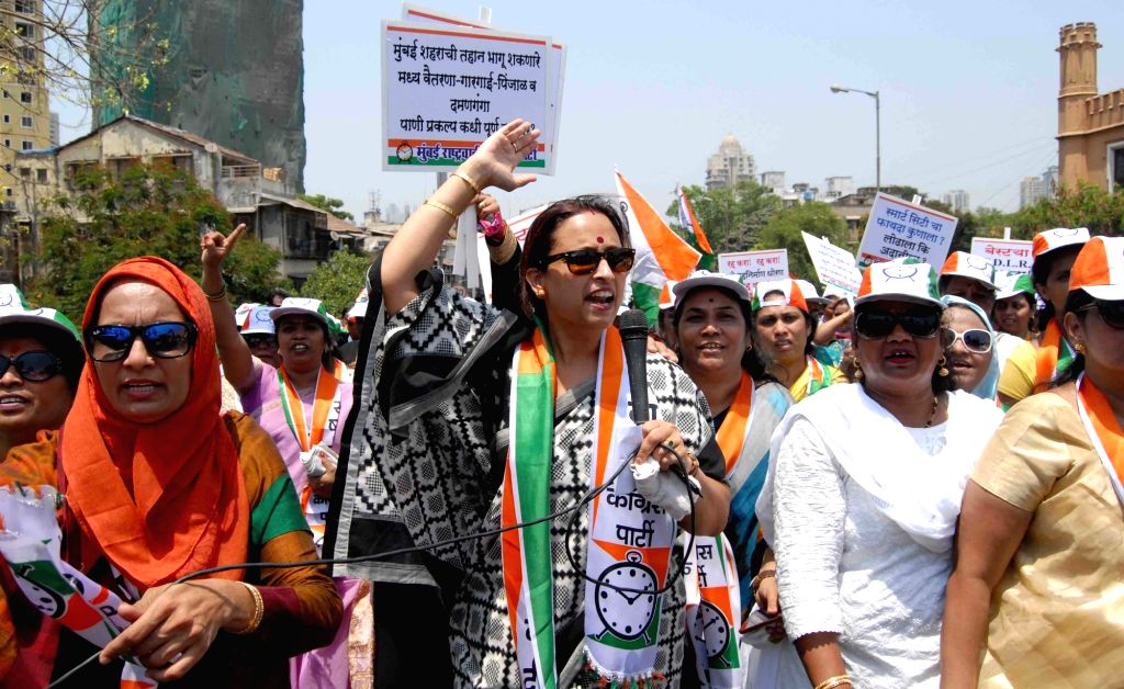 NCP workers participate in a rally against BJP in Mumbai on April 11, 2016.