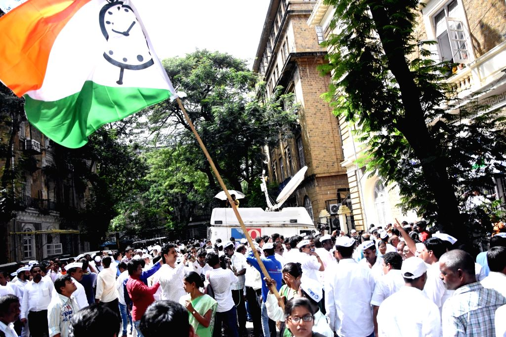 NCP workers stage a demonstration outside the Enforcement Directorate (ED) office to express solidarity with party President Sharad Pawar who prepared to appear before the ED, in Mumbai on ...