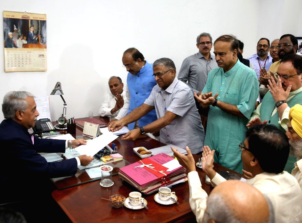 NDA candidate and JD-U leader Harivansh Narayan Singh submits his nomination for Rajya Sabha Deputy Chairman's post, in New Delhi on Aug 8, 2018. Also seen Union Ministers and BJP leaders ... - Harivansh Narayan Singh and Ananth Kumar