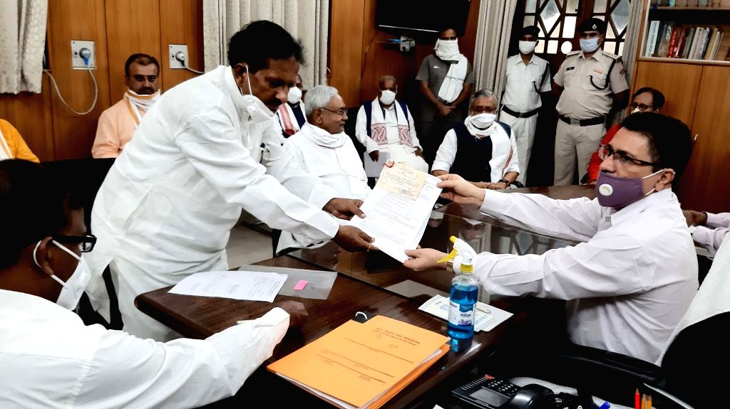 NDA candidate Ghulam Gaush Bhishma files his nomination papers for the Bihar Legislative Council (MLC) elections in the presence of Bihar Chief Minister and JD-U chief Nitish Kumar and Deputy ... - Sushil Kumar Modi and Nitish Kumar