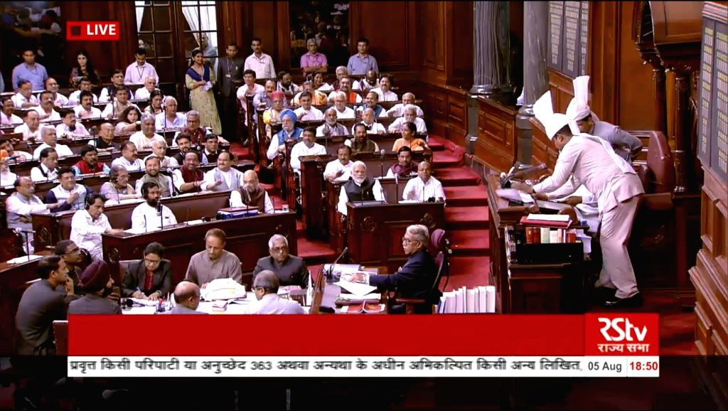 NDA MPs celebrate on after Rajya Sabha passed the Jammu and Kashmir Reorganisation Bill 2019 and adopted the resolution to abrogate the Constitution's Article 370 on Aug 5, 2019.