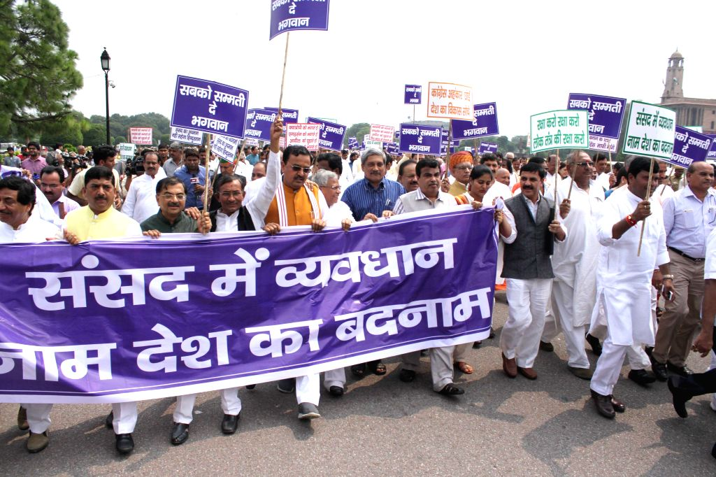 NDA MPs participate in `Save Democracy` rally at Vijay Chowk  in New Delhi, on Aug 13, 2015.