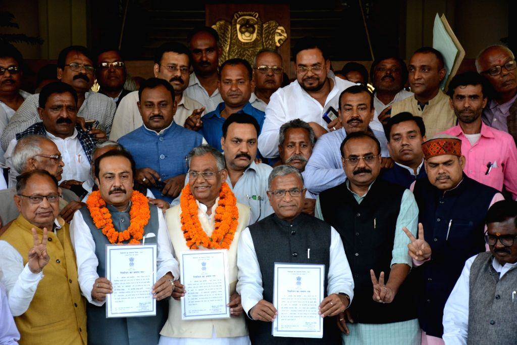 NDA's newly elected Rajya Sabha members show their certificates of election outside the Bihar Legislative Assembly, in Patna on March 18, 2020.