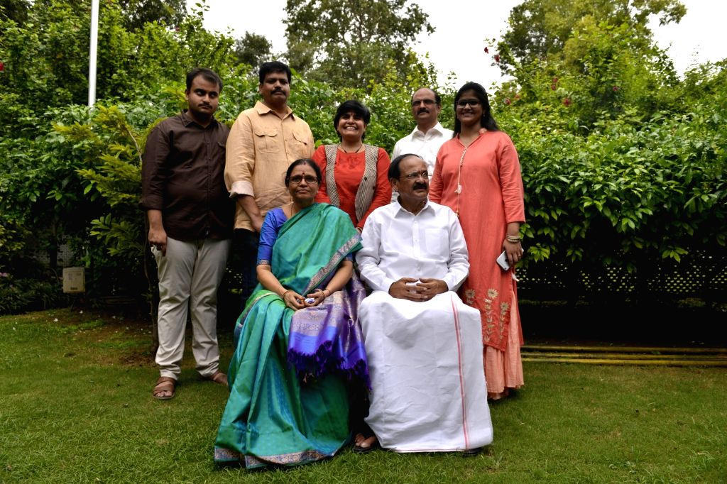 NDA Vice Presidential candidate M Venkiah Naidu with his wife and family members at his residence in New Delhi on Aug. 4, 2017. - M Venkiah Naidu