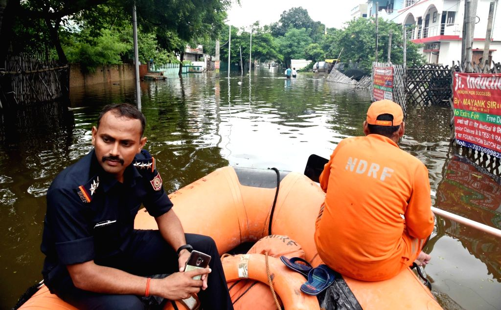 NDRF personnel carry out rescue and evacuation drive in flood affected Patna, on Sep 30, 2019.