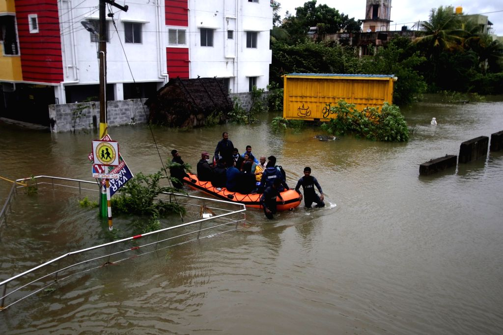 NDRF personnel carry out rescue and relief operations after very severe cyclonic storm Nivar wreaked havoc, in Chennai on Nov 26, 2020. According to the Tamil Nadu government, three persons ...