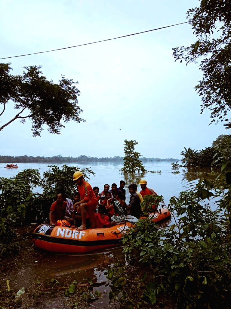 NDRF personnel conduct evacuation drive at Bokakhat in Assam's flood affected Golaghat district, on July 16, 2019.