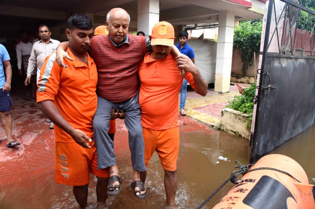NDRF personnel evacuate a man in flood affected Patna, on Sep 30, 2019.