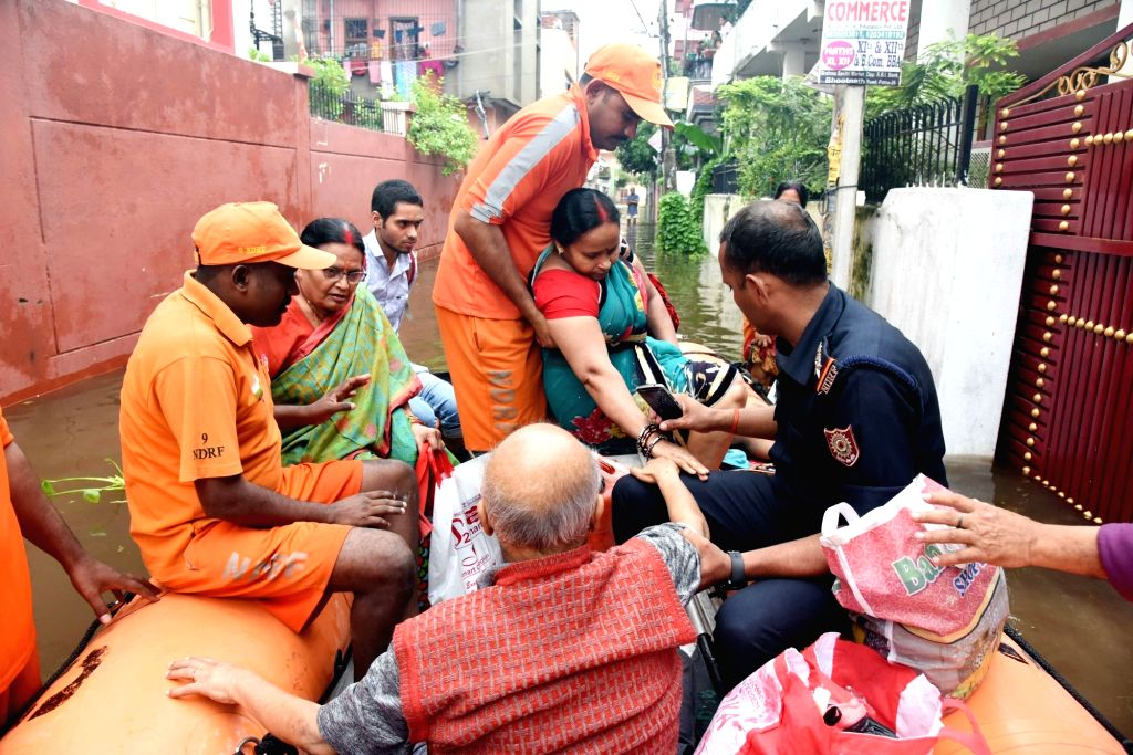 NDRF personnel evacuate people in flood affected Patna, on Sep 30, 2019.