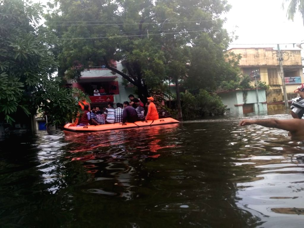 NDRF personnel evacuate people in Patna's flood affected Rajendra Nagar, on Sep 30, 2019.
