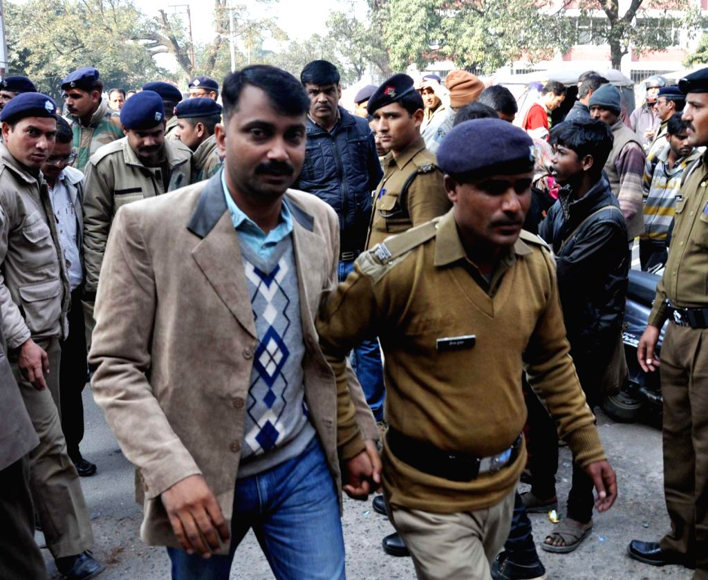 Neeraj Chauhan who is accused of making extortion calls to Additional Home Secretary J P Joshi being produced in a court in Dehradun on Dec.20, 2013. - Neeraj Chauhan