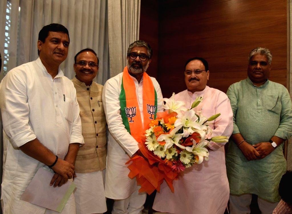 Neeraj Shekhar joins BJP in presence of party president JP Nadda in New Delhi on July 16, 2019.