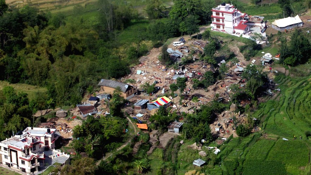 An aerial view of damaged houses occurred due to a recent massive earthquake in Nepal, taken by Indian Air Force (IAF) helicopter on its way to Dhadhing.