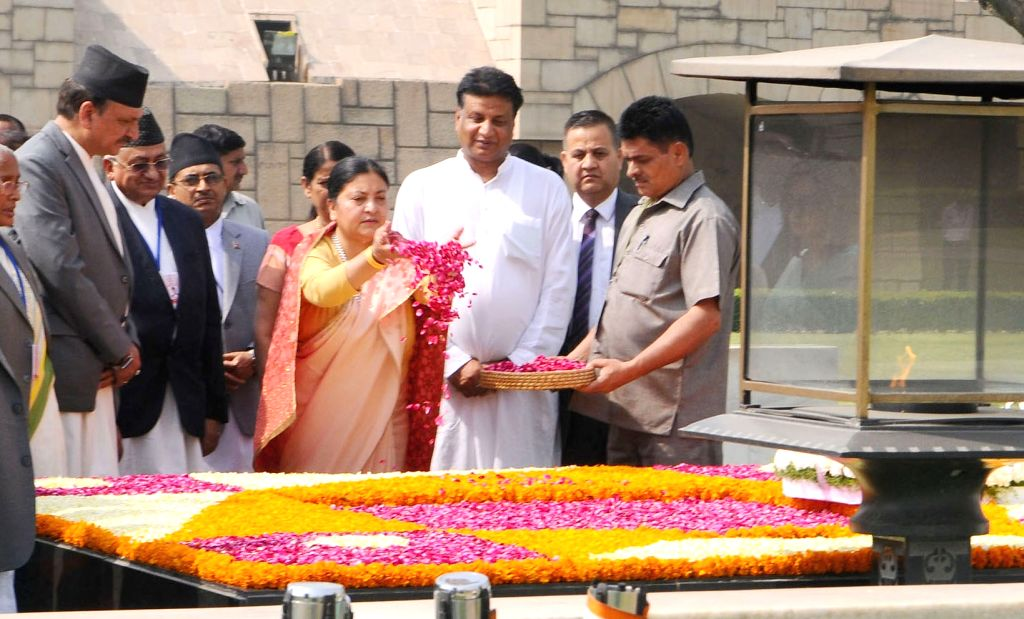 Nepal President Bidya Devi Bhandari pays tributes at the Samadhi of Mahatma Gandhi, at Rajghat, in Delhi on April 18, 2017.