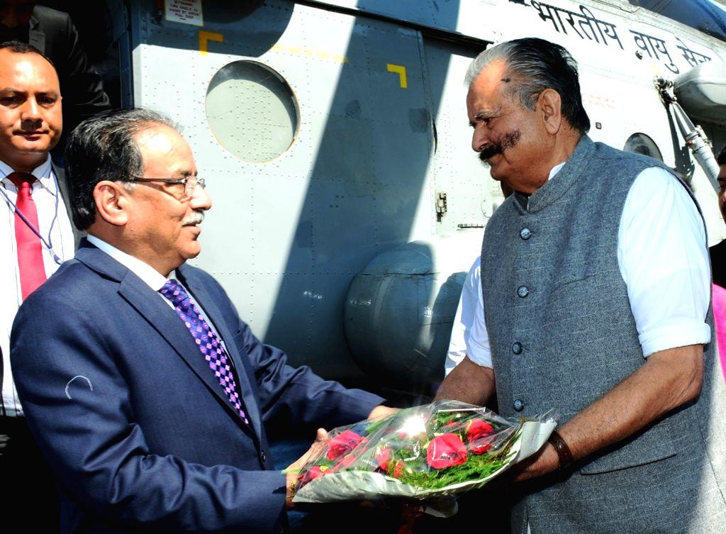 Nepal Prime Minister Pushpa Kamal Dahal being welcomed by Himachal Pradesh Power Minister Sujan Singh Pathania at Jhakri near Rampur in Shimla district of Himachal Pradesh on Sept 17, 2016. - Pushpa Kamal Dahal and Sujan Singh Pathania