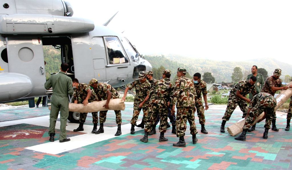 Relief material being offloaded from an Indian Air Force (IAF) Helicopter at Millanchi helipad of Nepal following a recent massive earthquake.