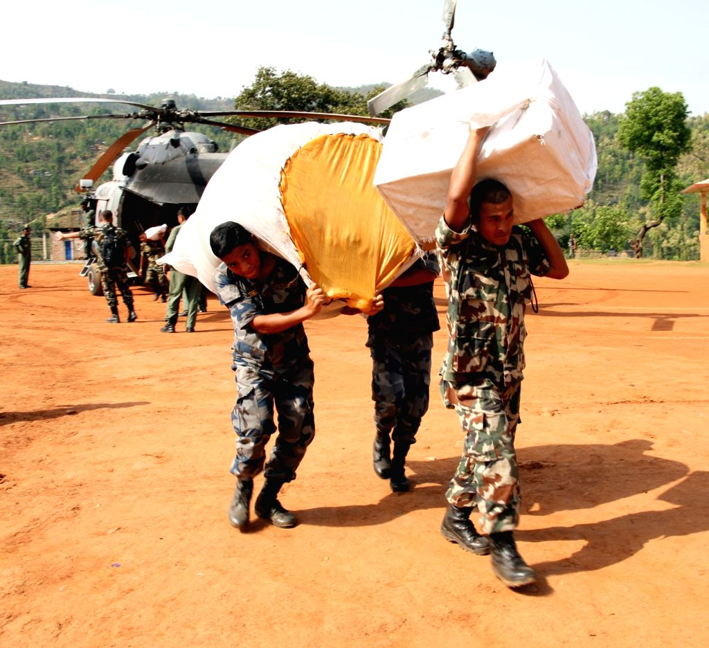 Relief material sent by Gujrat Government being offloaded from Indian Air Force (IAF) helicopters by Nepalese Army personnel at Dhadhing helipad in Nepal following a recent massive earthquake.