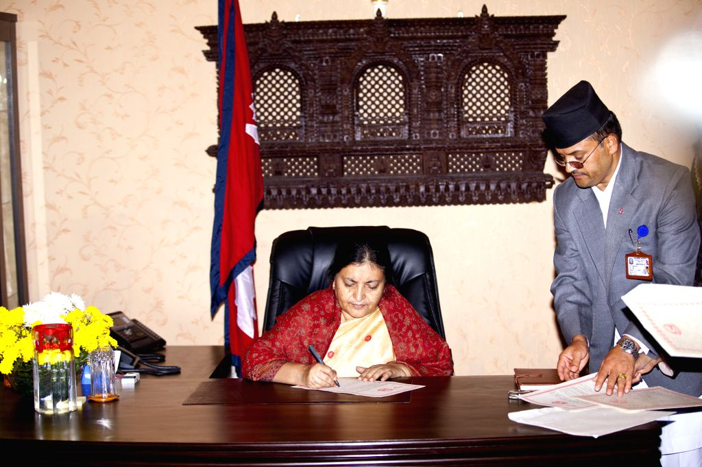 Nepal's newly elected President Bidhya Devi Bhandari (L) signs documents and assumes her post in Kathmandu, Nepal, Oct. 29, 2015. Newly-elected President Bidhya ...