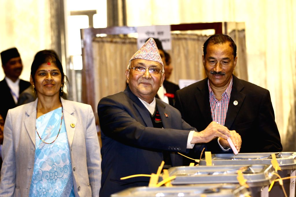 Nepal's Prime Minister KP Sharma Oli (C) votes at the Parliament in Kathmandu, Nepal, Oct. 31, 2015. Nepal's first vice-presidential election after the ...