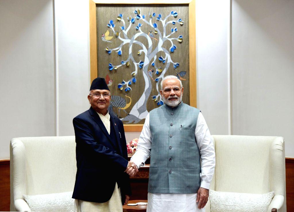 Nepal's Prime Minister KP Sharma Oli calls on Prime Minister Narendra Modi in New Delhi on April 6, 2018. - K and Narendra Modi