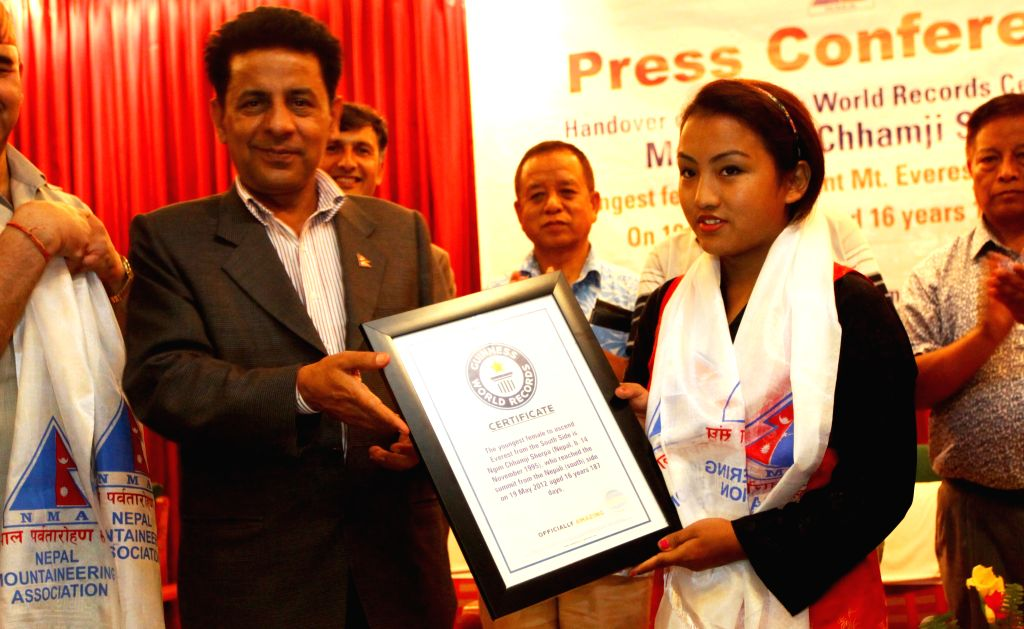 Nepalese girl Ngim Chhamji Sherpa (R), Guinness World Record holder for the youngest female to ascent Mount Qomolangma, poses for a photo with Nepalese Acting ...