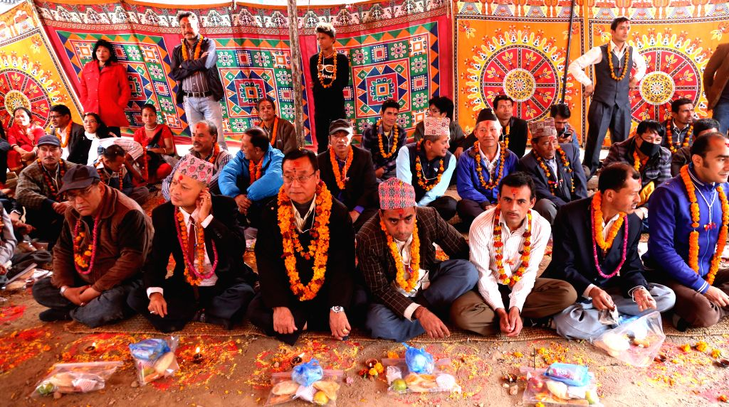 Nepalese people attend a group celebration during Bhai Tika, the fifth and last day of Tihar festival, at Ranipokhari in Kathmandu, Nepal, Nov. 13, 2015. Nepalese ...