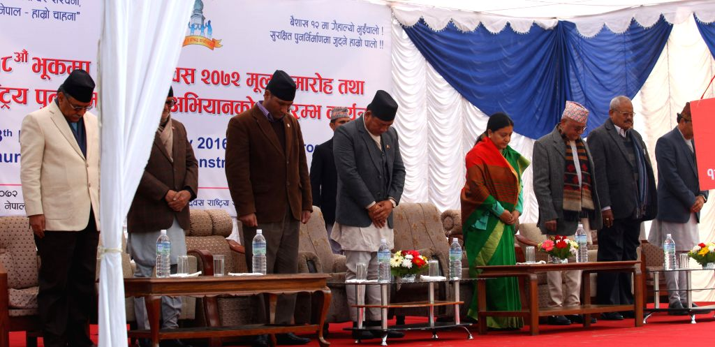 Nepalese President Bidhya Devi Bhandari (4th R) pays homage in memory of earthquake victims during the launching ceremony of a reconstruction program at ...