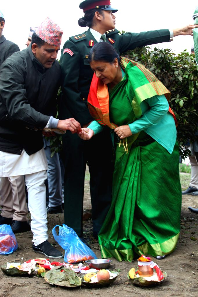 Nepalese President Bidhya Devi Bhandari (R, front) offers prayers before laying the foundation stone during the launching ceremony of a reconstruction program at ...