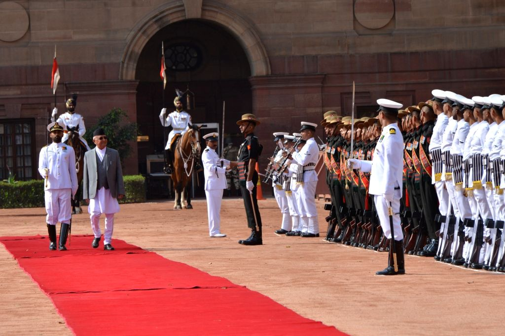 Nepalese Prime Minister K.P. Sharma Oli inspects the Guard of Honour during his Ceremonial Reception, at Rashtrapati Bhavan in New Delhi on April 7, 2018. - K. and P. Sharma Oli