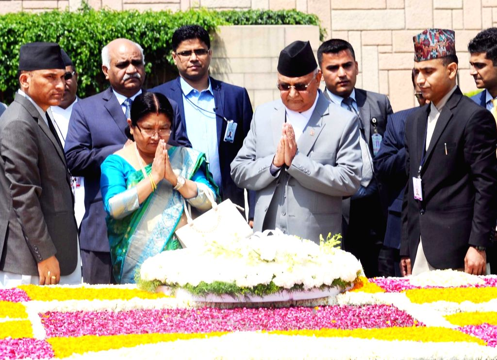 Nepalese Prime Minister K.P. Sharma Oli pays homage at the Samadhi of Mahatma Gandhi at Rajghat in Delhi on April 7, 2018. - K. and P. Sharma Oli
