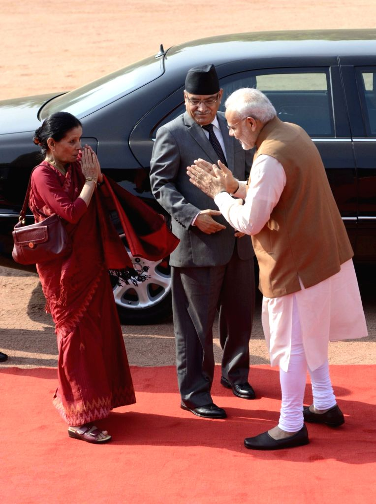 Nepalese Prime Minister Pushpa Kamal Dahal and Sita Dahal being received by Prime Minister Narendra Modi during a Ceremonial Reception organised for Dahal at Rashtrapati Bhavan, in New ... - Pushpa Kamal Dahal and Narendra Modi