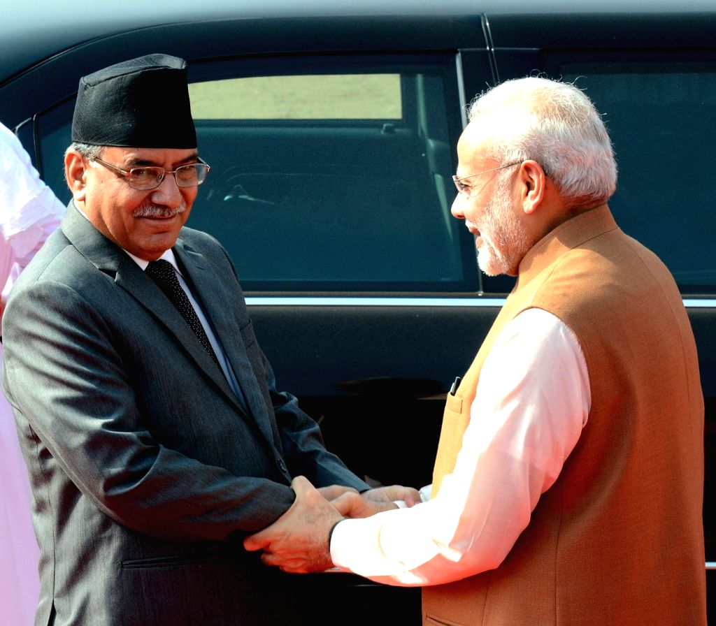 Nepalese Prime Minister Pushpa Kamal Dahal or Prachanda shakes hands with his Indian counterpart Narendra Modi (right) during the ceremonial reception at Rashtrapati Bhavan in New Delhi on ... - Pushpa Kamal Dahal and Narendra Modi