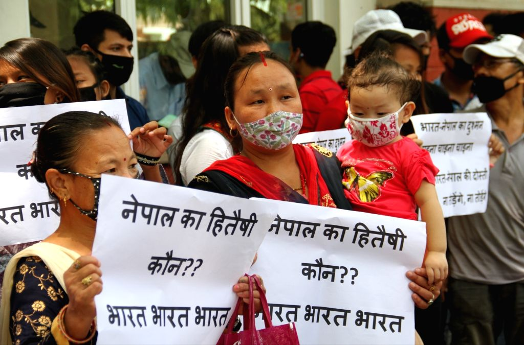 Nepali nationals living in India stage a demonstration outside the Embassy of Nepal in New Delhi on July 13, 2020.